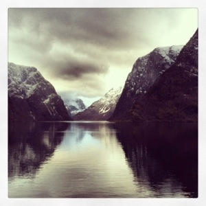 The Norwegian fjords! While it was cold enough for Frosty the Snowman when I visited in March, it's absolutely breathtaking during the summer!