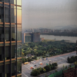View from the Conrad Seoul of the sun rising over the Han River