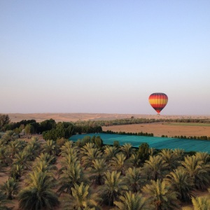 Sunrise hot air balloon ride over the desert of Dubai, UAE.